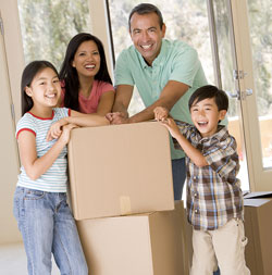 Family of four with moving boxes